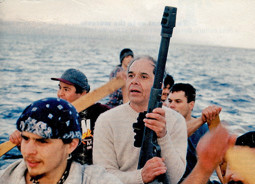 "Makah Whaling crew; Captain Wayne Johnson holds the ""traditional"" 50-caliber rifle which is to be used to kill the whale."