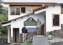 Sea Shepherd Galapagos Director Sean O'Hearn with Captain Watson in front of the new office.